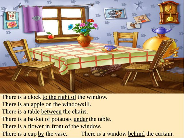 There is a clock to the right of the window. There is an apple on the windows...