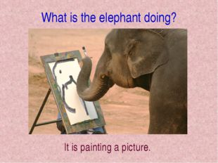 What is the elephant doing? It is painting a picture.
