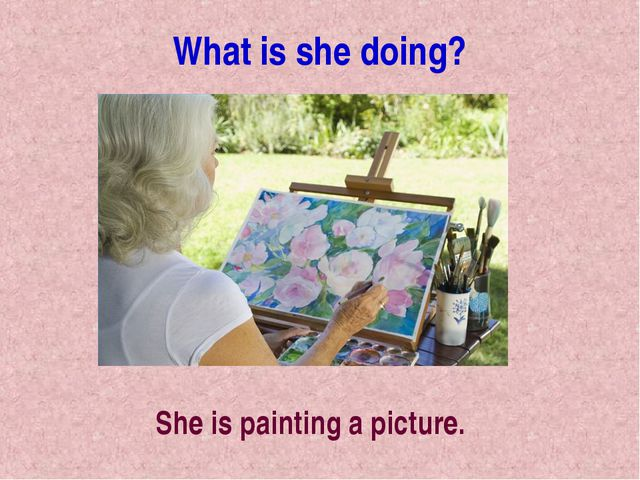What is she doing? She is painting a picture.