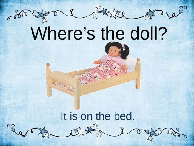 Where's the doll? It is on the bed.