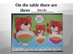 On the table there are three __________ bowls