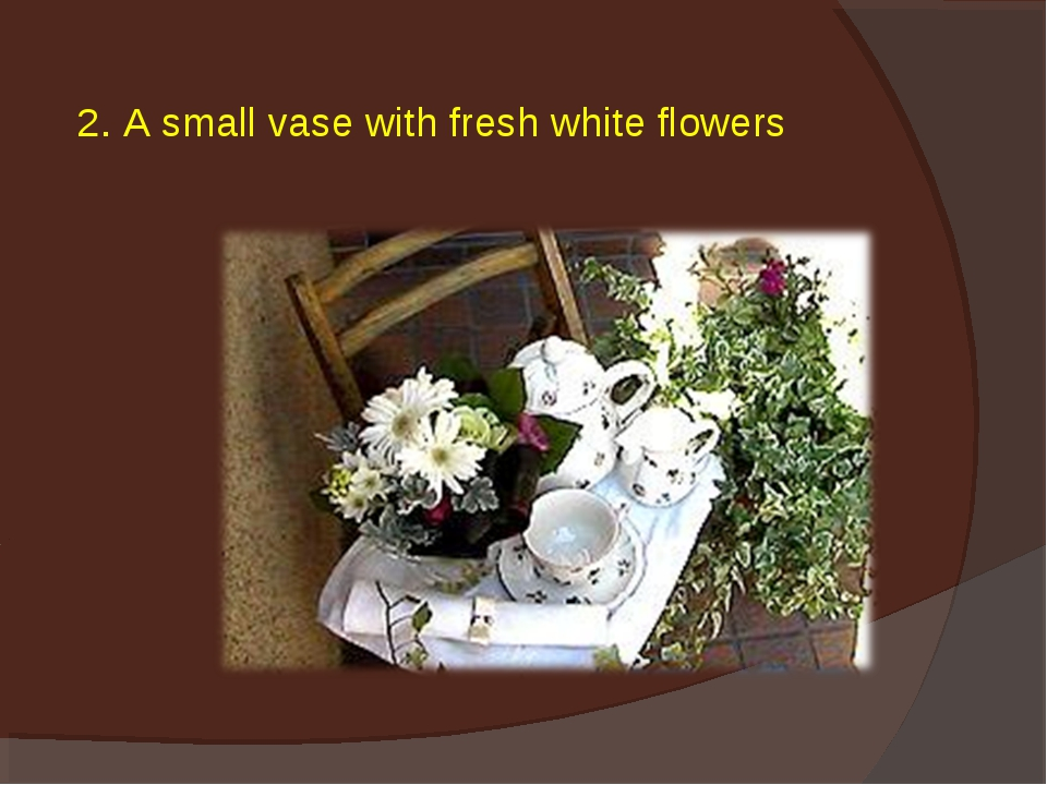 2. A small vase with fresh white flowers