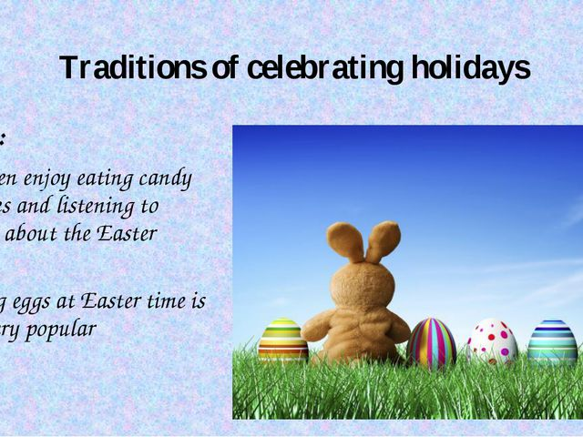 Traditions of celebrating holidays Easter: Children enjoy eating candy bunnie...