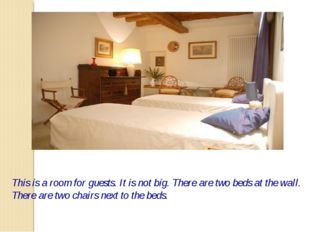This is a room for guests. It is not big. There are two beds at the wall. The