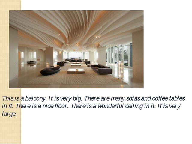 This is a balcony. It is very big. There are many sofas and coffee tables in...
