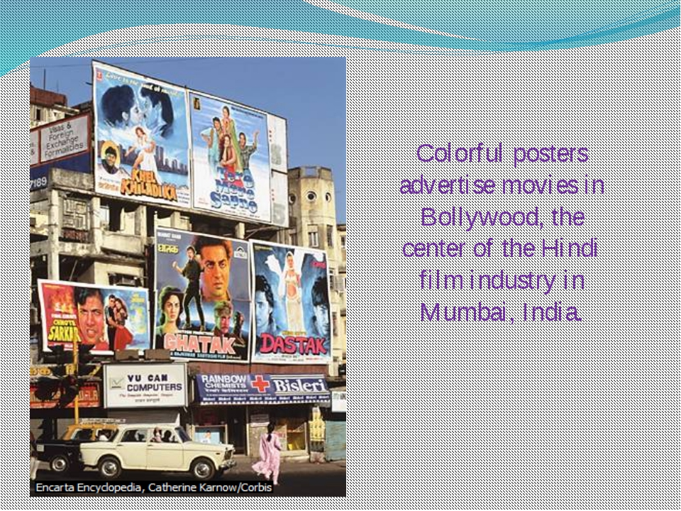 Colorful posters advertise movies in Bollywood, the center of the Hindi film...