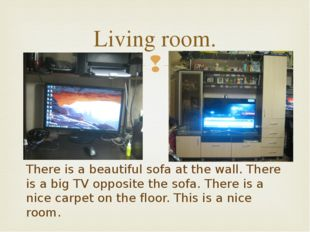 Living room. There is a beautiful sofa at the wall. There is a big TV opposit