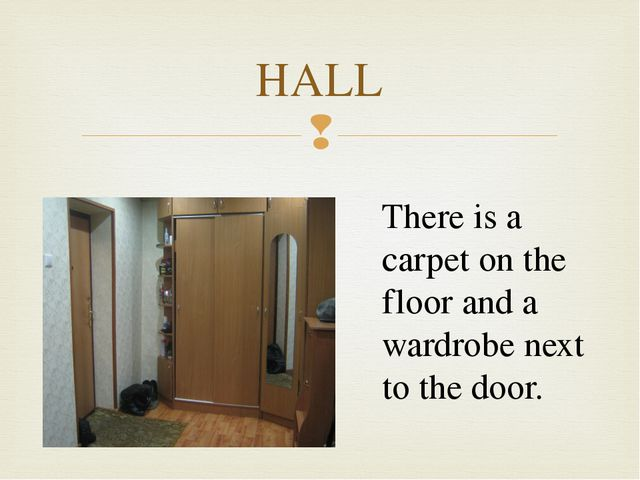 HALL There is a carpet on the floor and a wardrobe next to the door. 