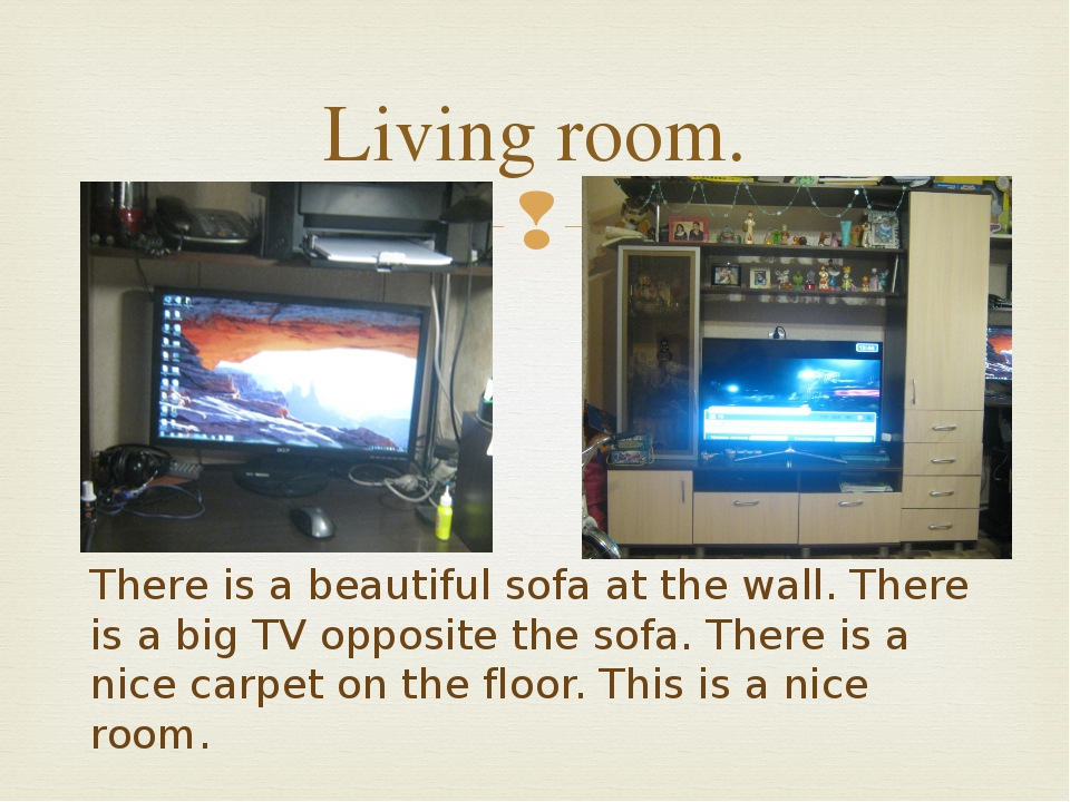 Living room. There is a beautiful sofa at the wall. There is a big TV opposit...