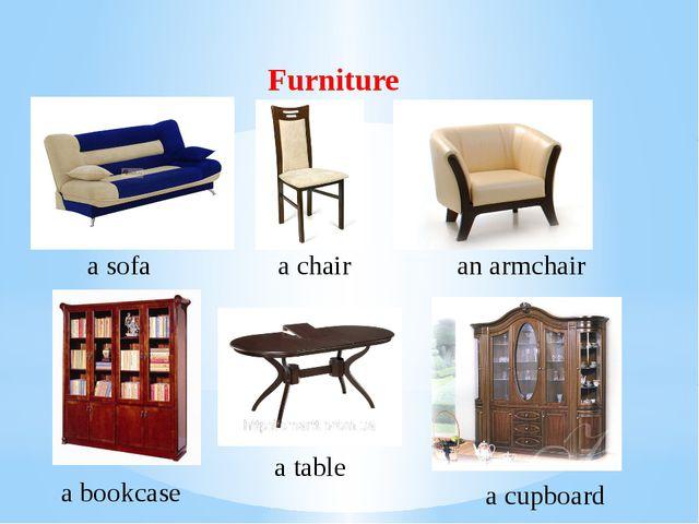 Furniture a sofa a chair an armchair a bookcase a table a cupboard