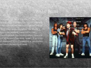 1990-е годы После выхода Blow Up Your Video из группы ушёл Саймон Райт и был