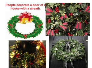People decorate a door of a house with a wreath.
