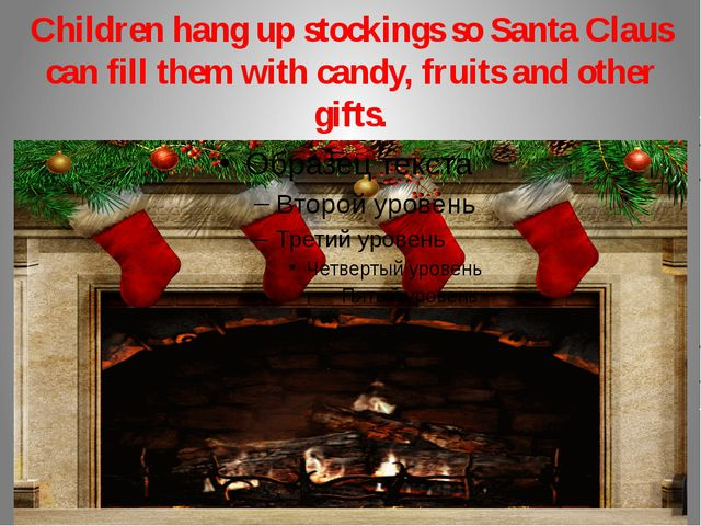 Children hang up stockings so Santa Claus can fill them with candy, fruits an...