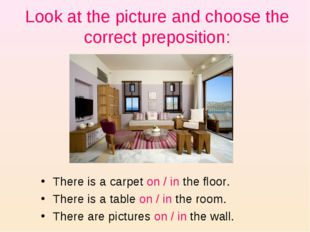 Look at the picture and choose the correct preposition: There is a carpet on