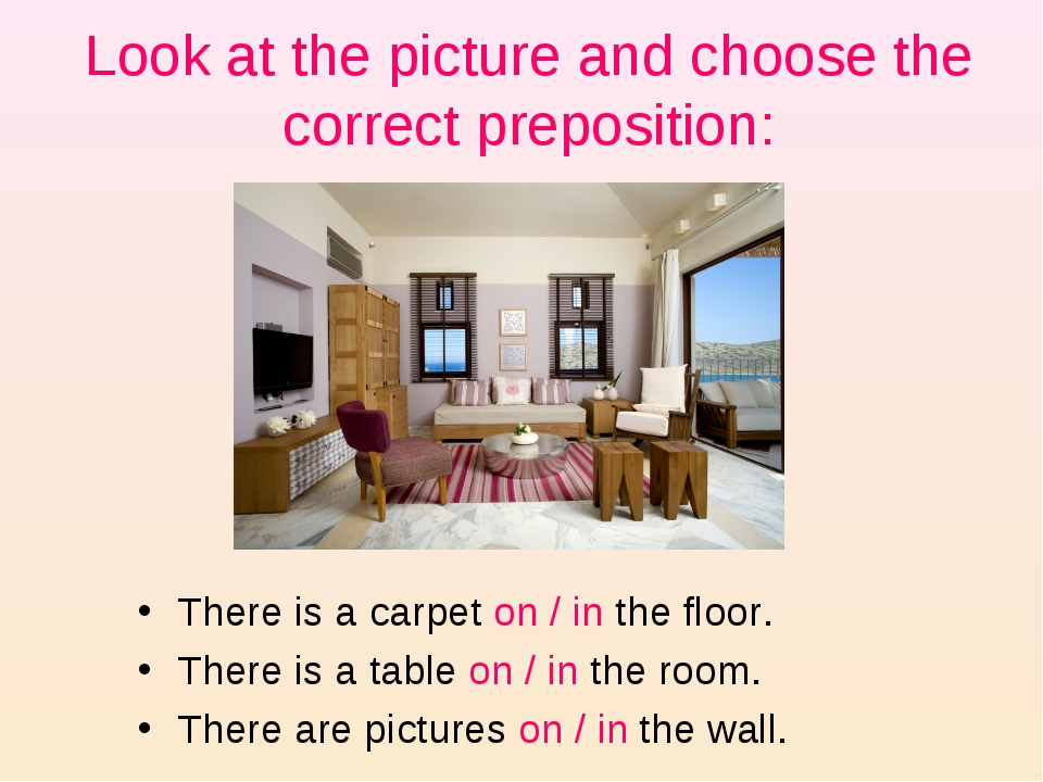 Look at the picture and choose the correct preposition: There is a carpet on...
