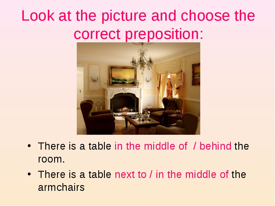 Look at the picture and choose the correct preposition: There is a table in t...