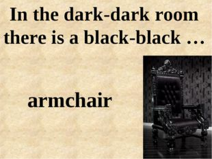 In the dark-dark room there is a black-black … armchair
