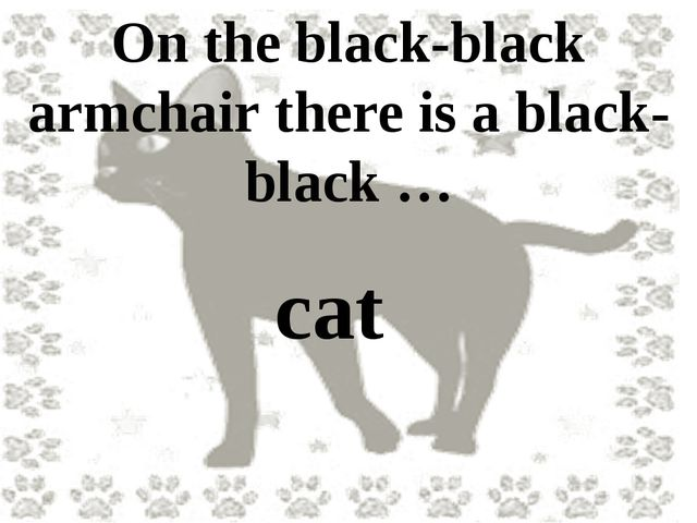 On the black-black armchair there is a black-black … cat