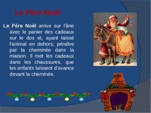 Le Père Noël Le Père Noël arrive sur l'âne avec le panier des cadeaux sur le
