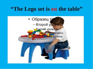 """The Lego set is on the table"""