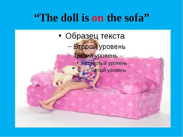 """The doll is on the sofa"""