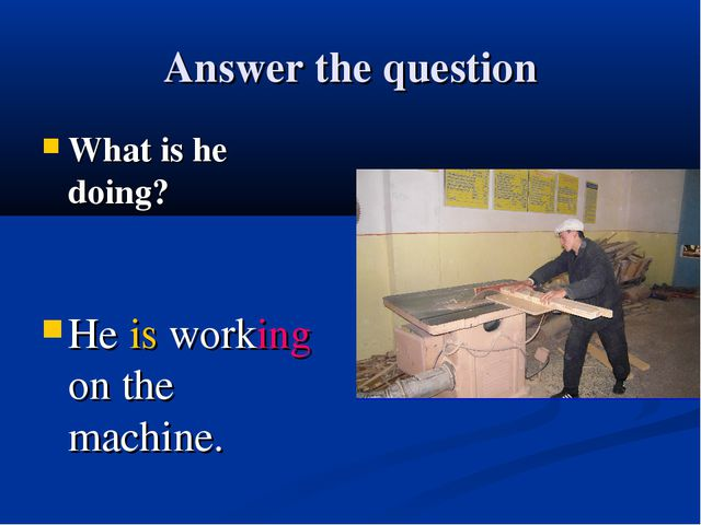 Answer the question What is he doing? He is working on the machine.