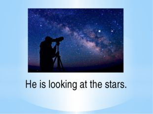 He is looking at the stars.