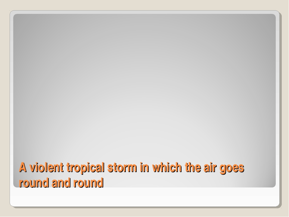 A violent tropical storm in which the air goes round and round