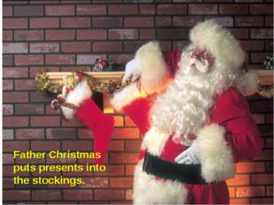 Father Christmas puts presents into the stockings.