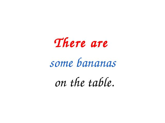 There are some bananas on the table.