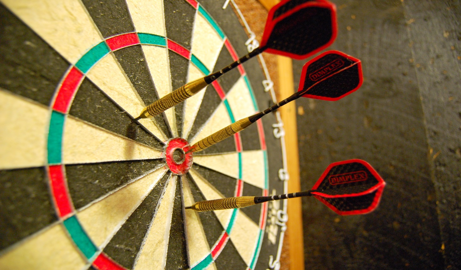 http://upload.wikimedia.org/wikipedia/commons/f/fb/Darts_in_a_dartboard.jpg