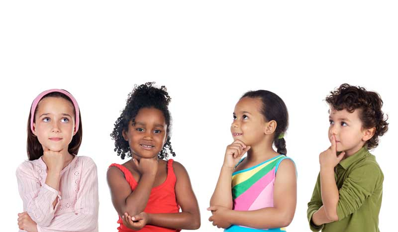 Multiethnic Group Of Children Thinking A Over White Background Фотография, картинки, изображения и сток-фотография без роялти. I