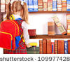 stock-photo-child-with-backpack-looking-on-book-in-library-rear-view-109977428