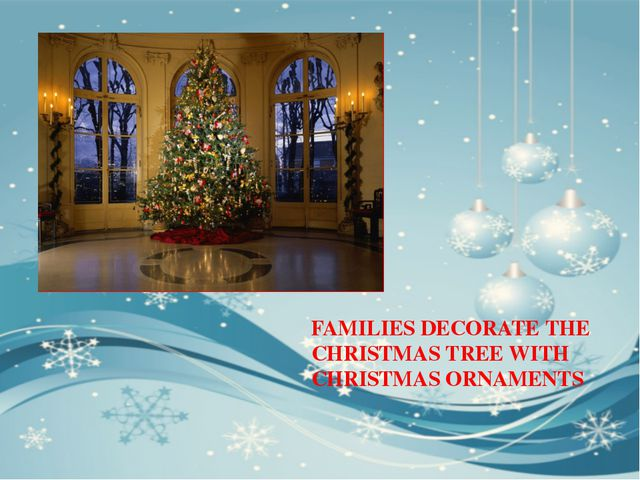 FAMILIES DECORATE THE CHRISTMAS TREE WITH CHRISTMAS ORNAMENTS