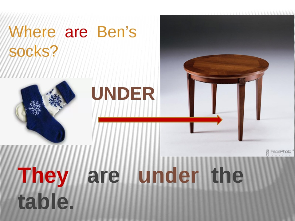 They are under the table. Where are Ben's socks? UNDER