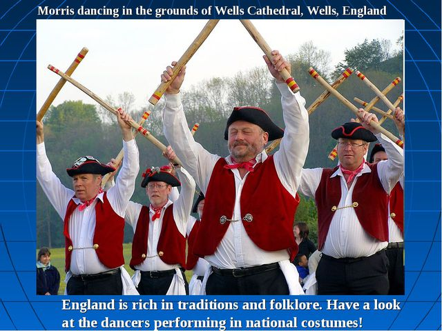 Morris dancing in the grounds of Wells Cathedral, Wells, England England is r...