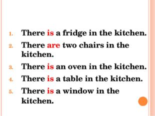 There is a fridge in the kitchen. There are two chairs in the kitchen. There
