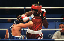 https://upload.wikimedia.org/wikipedia/commons/thumb/2/22/Boxing_at_the_2000_Olympic_games.JPEG/220px-Boxing_at_the_2000_Olympic_games.JPEG
