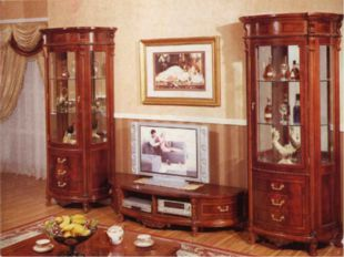 5. There is a TV set, a wall-unit, some chairs and sofa in this room. Some p