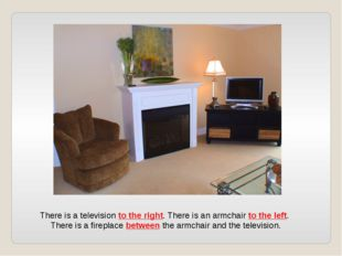 There is a television to the right. There is an armchair to the left. There i