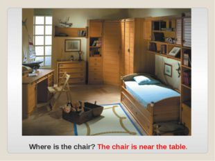 Where is the chair? The chair is near the table.