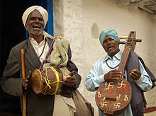 http://upload.wikimedia.org/wikipedia/commons/thumb/a/ac/India_village_musicians.jpg/220px-India_village_musicians.jpg