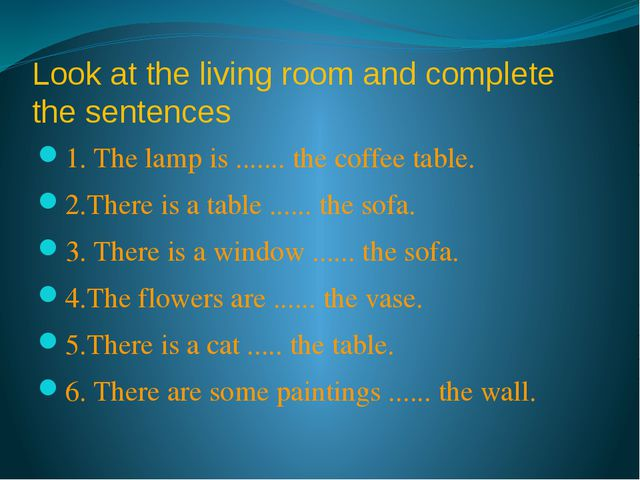 Look at the living room and complete the sentences 1. The lamp is ....... the...