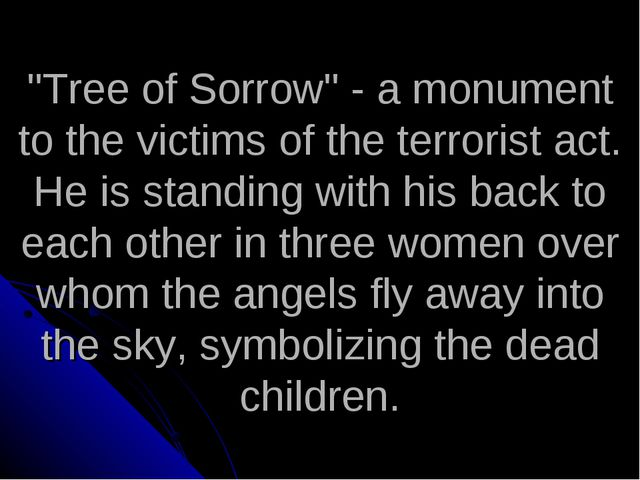 """Tree of Sorrow"" - a monument to the victims of the terrorist act. He is stan..."