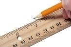Someone Is Using A Ruler And Pencil To Make A Drawing On White Paper. Фотография, картинки, изображения и сток-фотография без ро