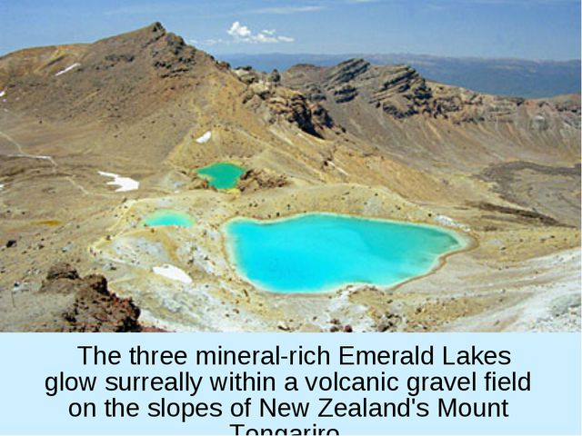 The three mineral-rich Emerald Lakes glow surreally within a volcanic gravel...