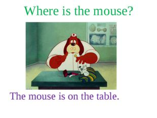 Where is the mouse? The mouse is on the table.