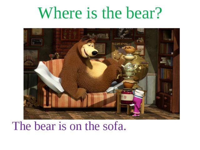Where is the bear? The bear is on the sofa.