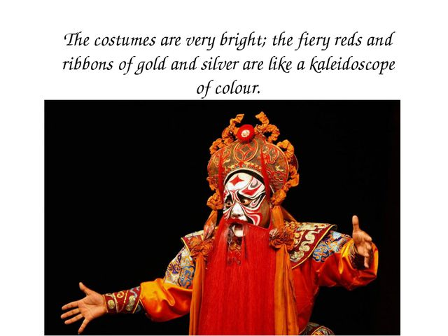 The costumes are very bright; the fiery reds and ribbons of gold and silver a...