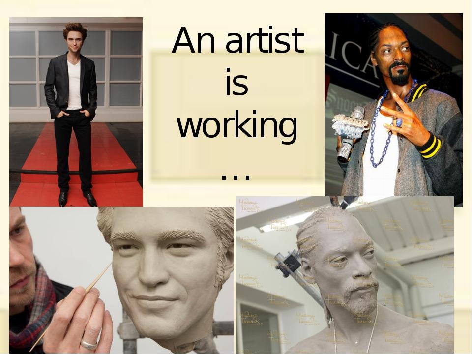 An artist is working…